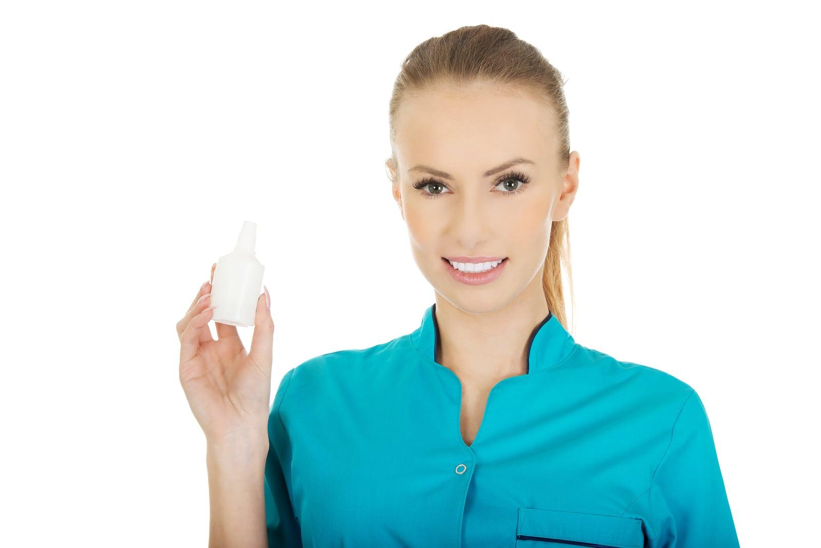 Nurse in uniform with hydrogen peroxide.
