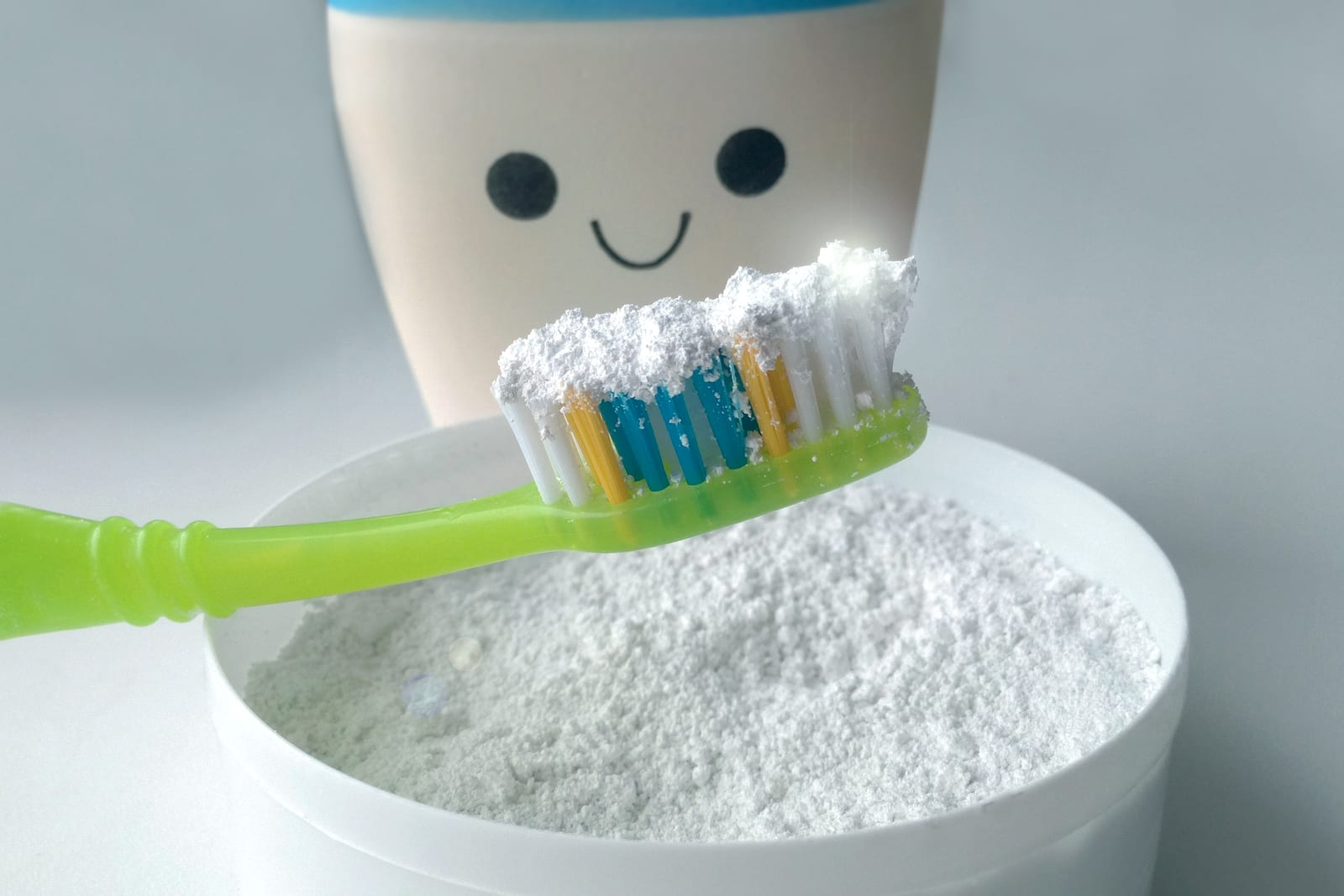 Tooth powder and brush good cleaning for healthy teeth, a symbol of natural cleanliness and care